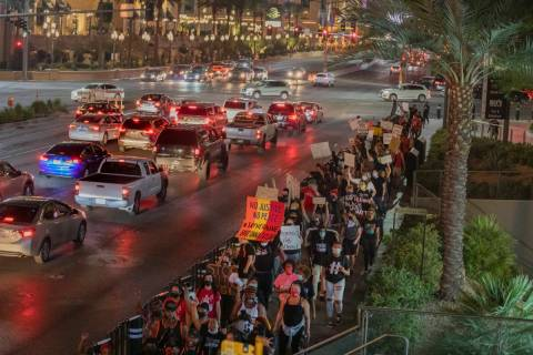 Protesters march to call for justice for Breonna Taylor on the Las Vegas Strip, Thursday, Sept. ...