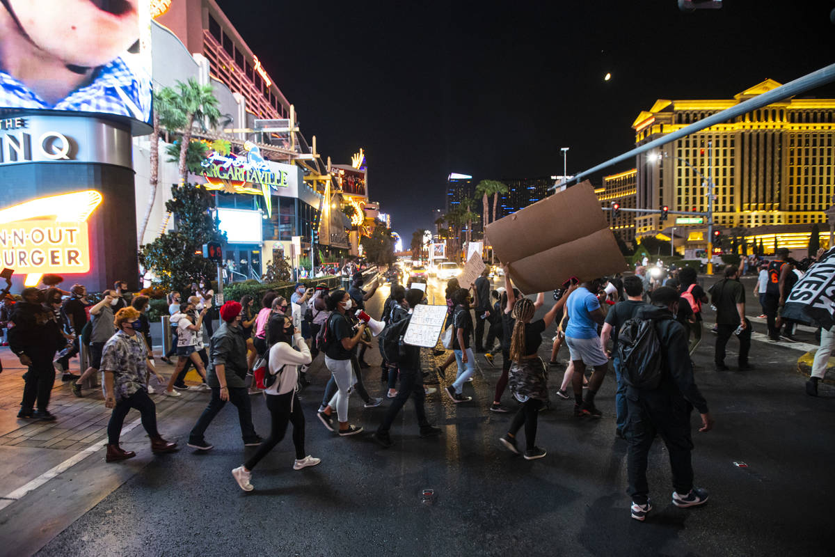 Protesters march along the Las Vegas Strip to call for justice for Breonna Taylor on Thursday, ...