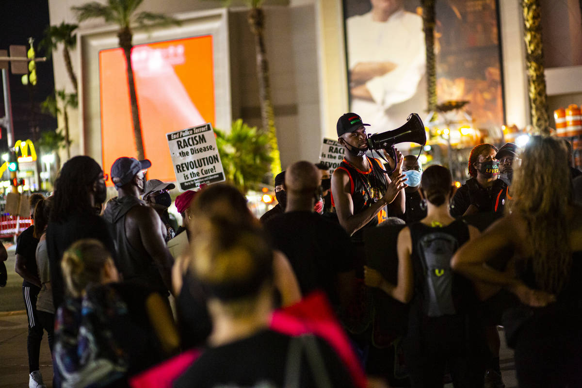 "Minister Vance ""Stretch"" Sanders, right, addresses protesters before marching along t ..."