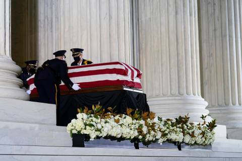 The flag-draped casket of Justice Ruth Bader Ginsburg arrives at the Supreme Court in Washingto ...