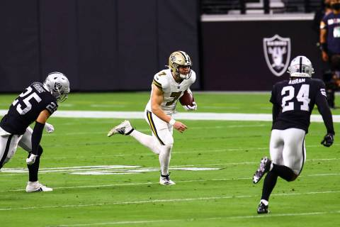 New Orleans Saints quarterback Taysom Hill (7) runs the ball between Las Vegas Raiders free saf ...
