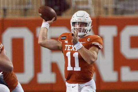 Texas' Sam Ehlinger (11) looks to pass against UTEP during the first half of an NCAA college fo ...