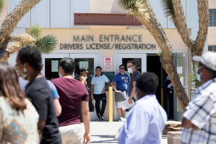 People wait in line at the Nevada Department of Motor Vehicles at 8250 West Flamingo Road on Mo ...