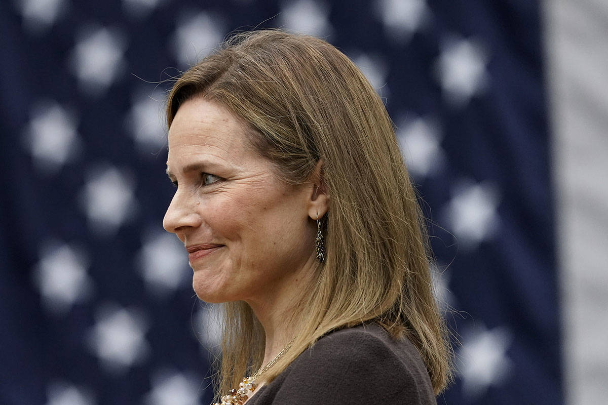 Judge Amy Coney Barrett listens as President Donald Trump announces Barrett as his nominee to t ...
