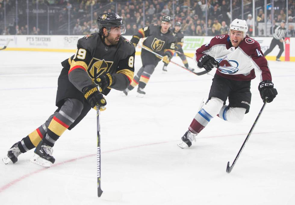 Golden Knights right wing Alex Tuch (89) pushes the puck up ice past Colorado Avalanche defense ...