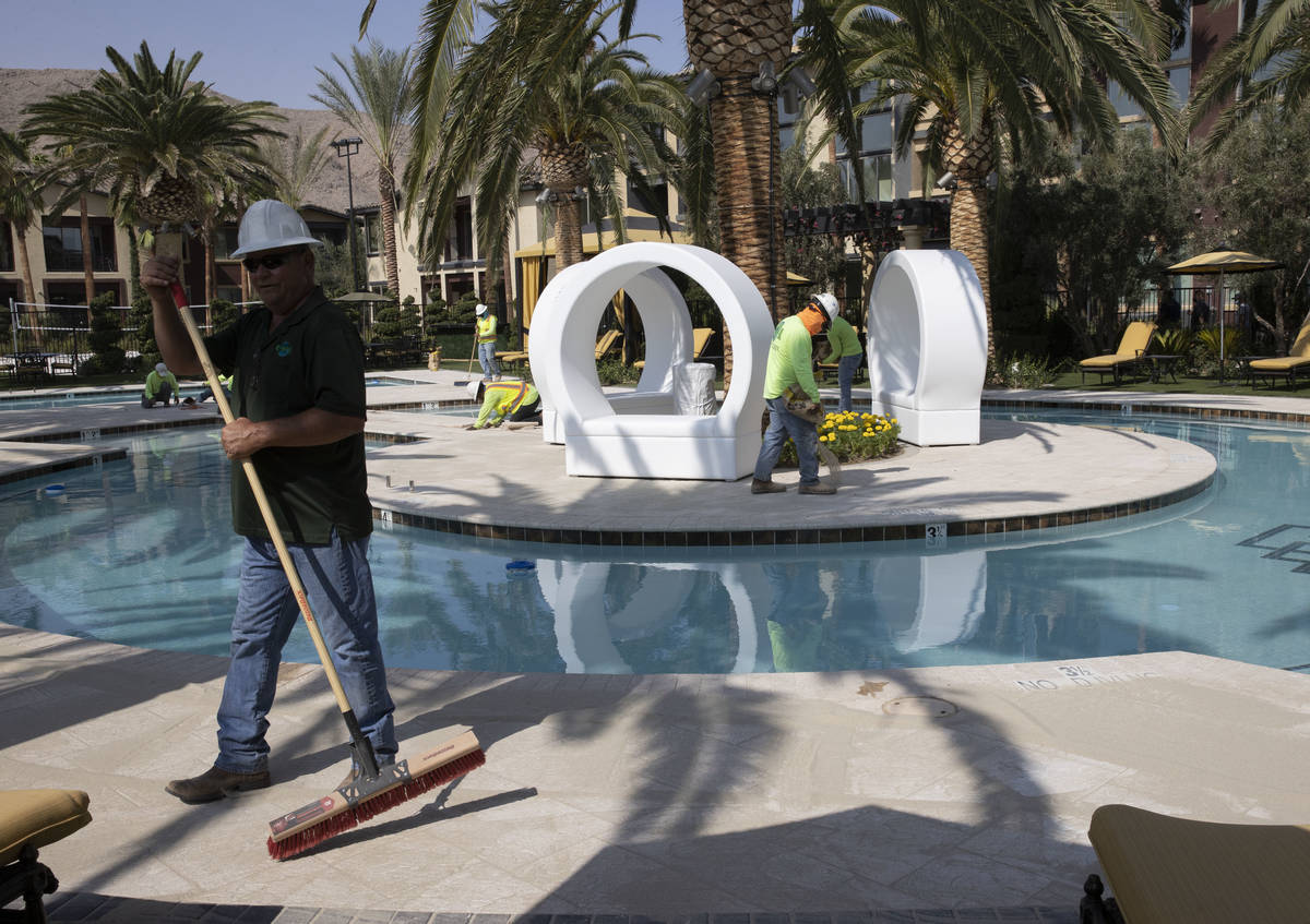 Crews are working at pool area at the Tuscan Highlands apartment complex under construction nea ...