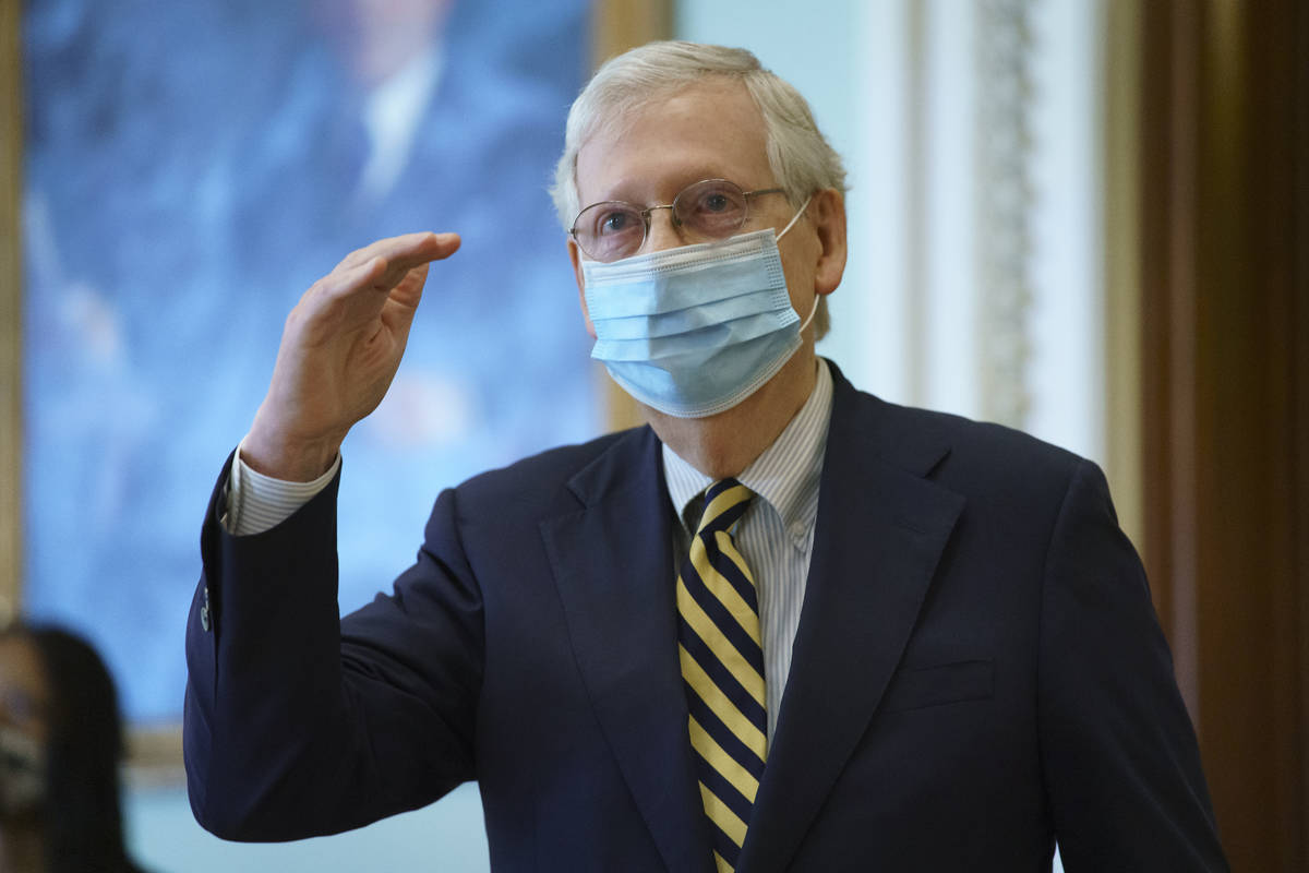 Senate Majority Leader Mitch McConnell, R-Ky., departs the chamber after speaking about the dea ...
