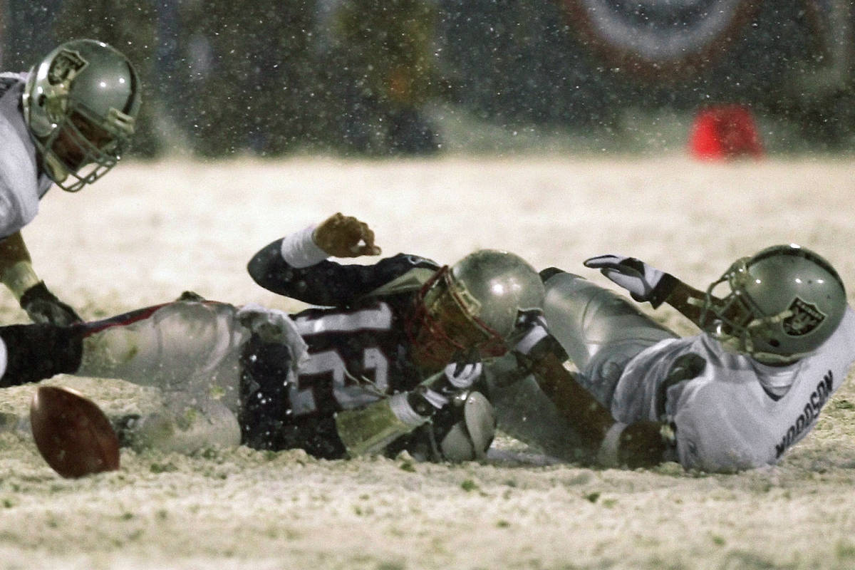 File-New England Patriots quarterback Tom Brady (12) loses the ball after being brought down by ...
