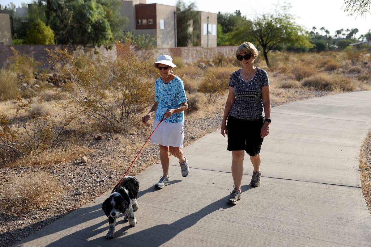 Katie Craven, right, 67, and her mother, Ruth Sidorowicz, 91, walk Sidorowicz's cocker spaniel ...