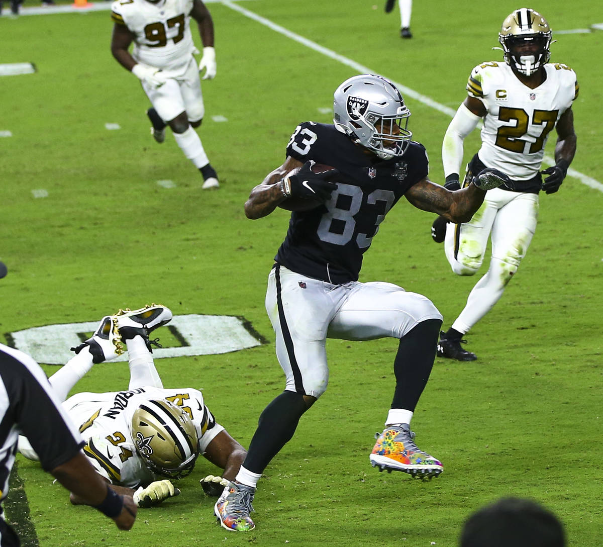 Las Vegas Raiders tight end Darren Waller (83) runs the ball past New Orleans Saints defensive ...