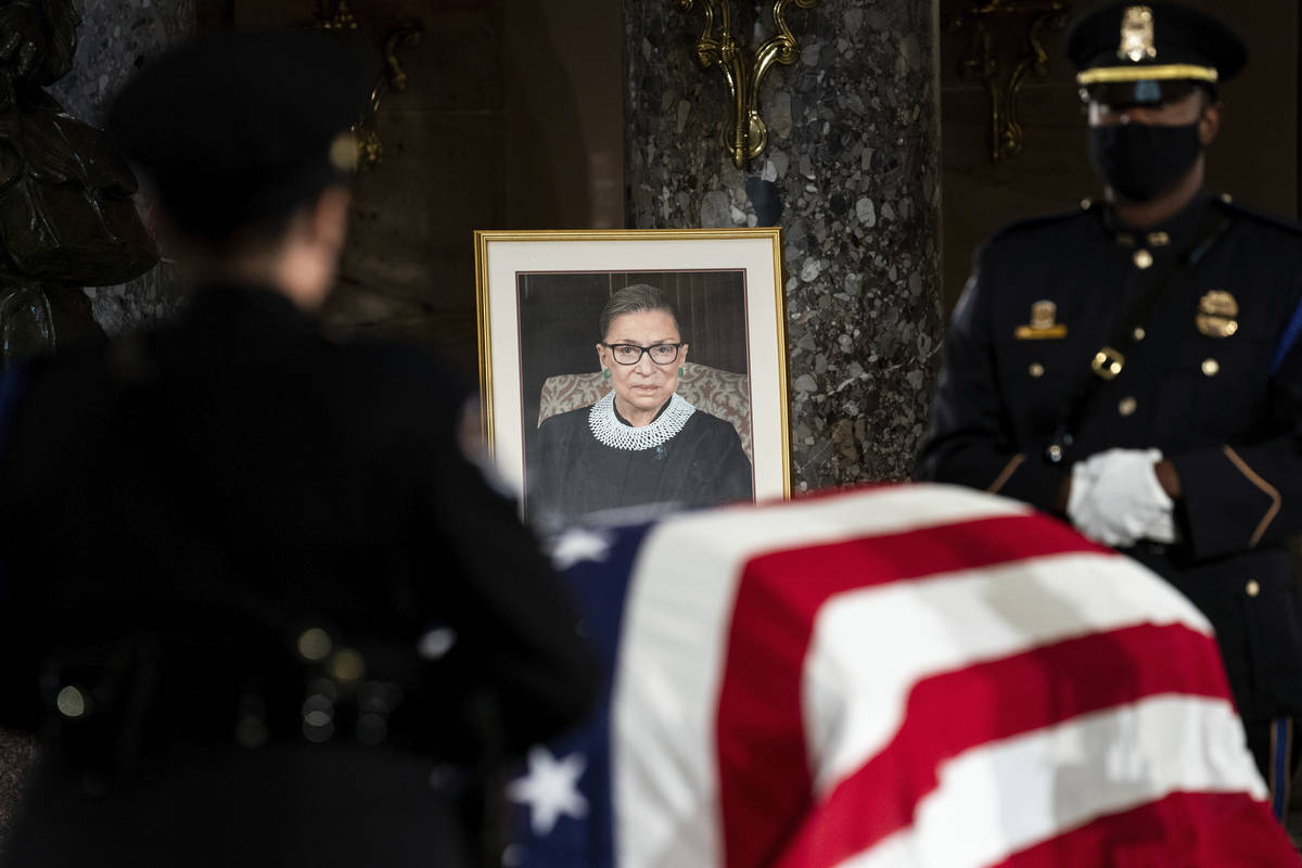 The flag-draped casket of Justice Ruth Bader Ginsburg lies in state in the U.S. Capitol on Frid ...
