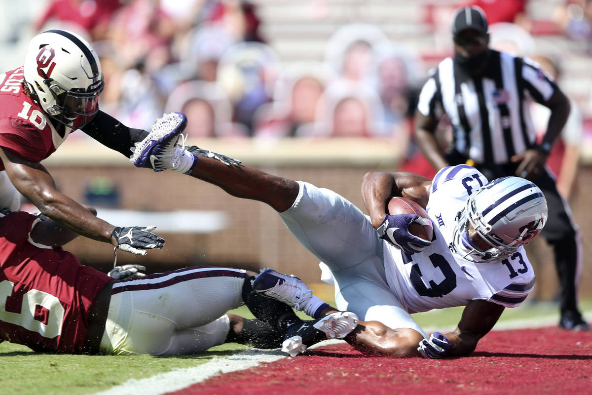 Kansas State wide receiver Chabastin Taylor (13) catches a touchdown pass in front of Oklahoma ...