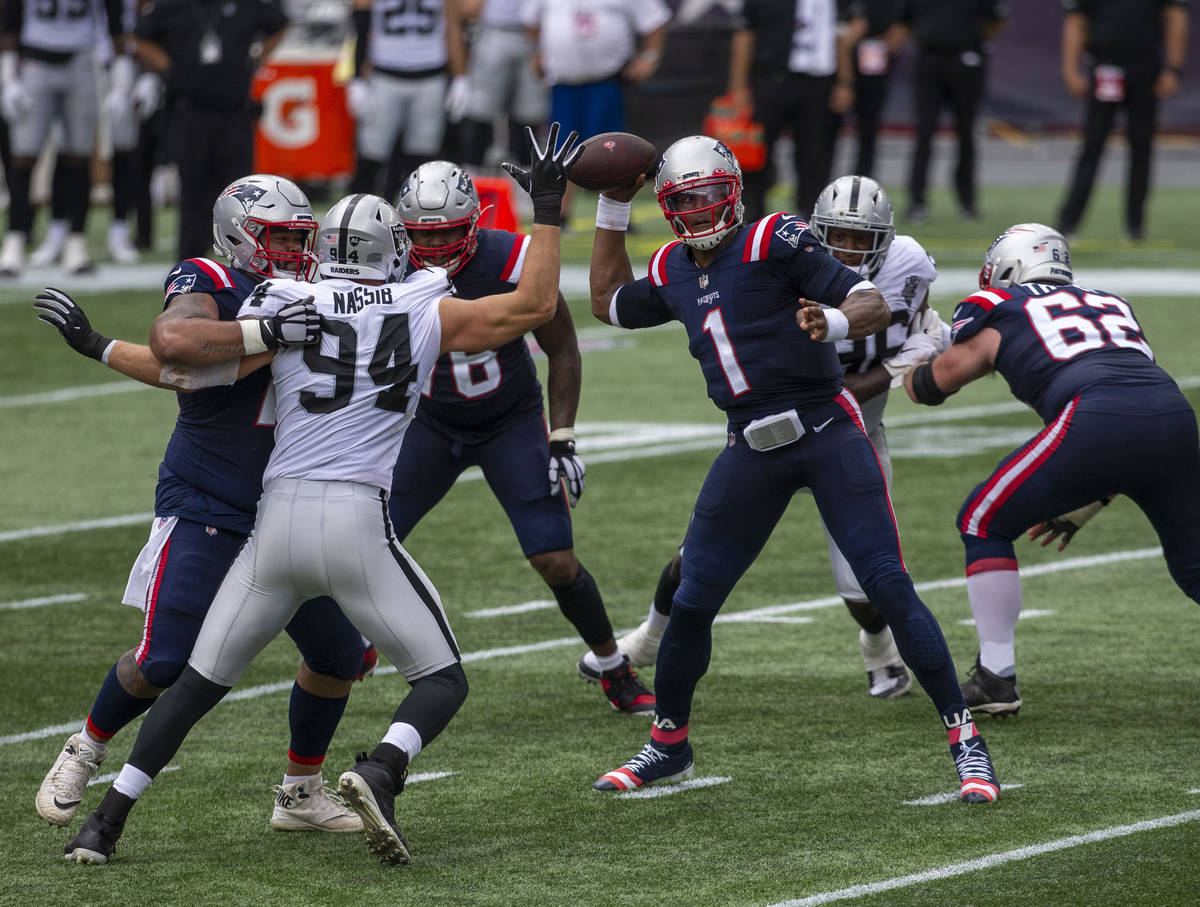 Las Vegas Raiders defensive end Carl Nassib (94) reaches out to get a hand on a pass thrown by ...