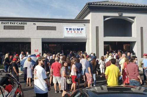A crowd waits outside the Summerlin office of President Trump's re-election campaign Saturday ...