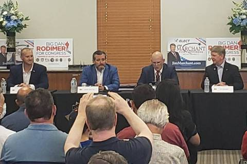 Sen. Ted Cruz, R-Texas, center, campaigns in Las Vegas on Saturday with Republican congressiona ...