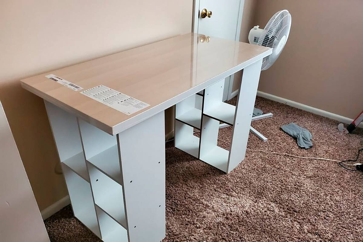 A desk Megan Fry constructed out of a legless tabletop and bookcases stands in her Indianapolis ...