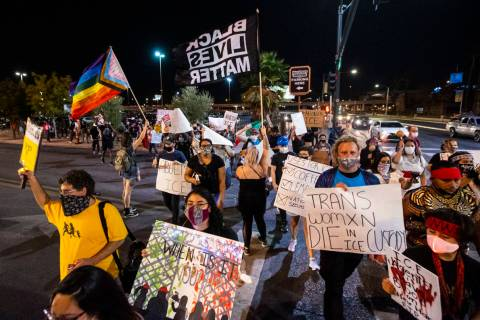 People march during a protest against U.S. Immigration and Customs Enforcement (ICE) in downtow ...