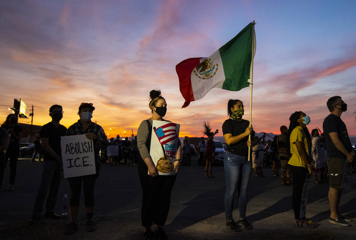 People gather before marching downtown to protest against U.S. Immigration and Customs Enforcem ...
