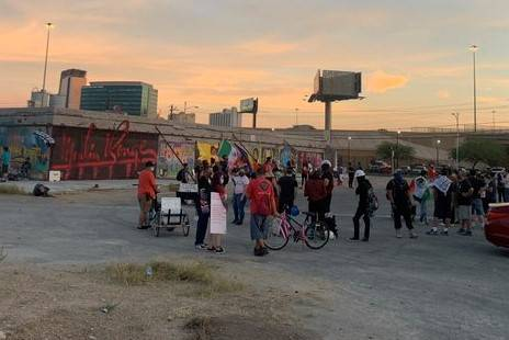 People gather in central Las Vegas on Saturday night to protest ICE. (Alexis Ford/Las Vegas Rev ...