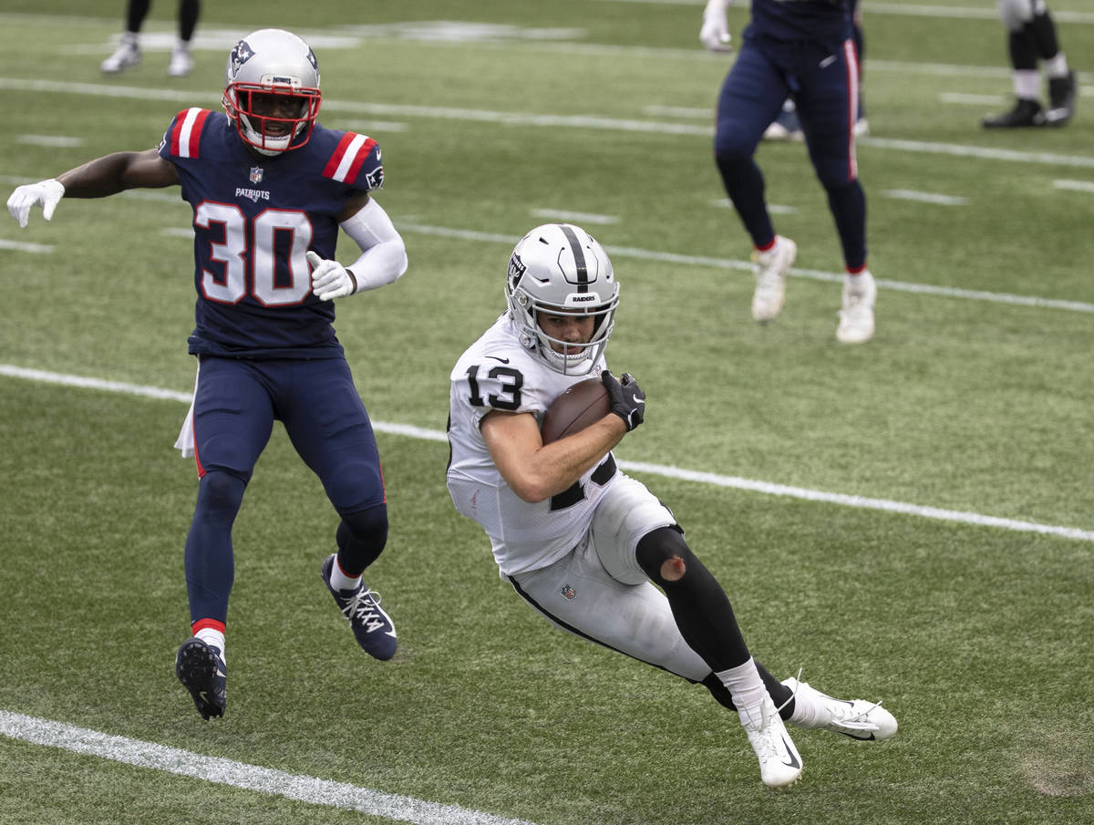 Las Vegas Raiders wide receiver Hunter Renfrow (13) leaps into the end zone past New England Pa ...