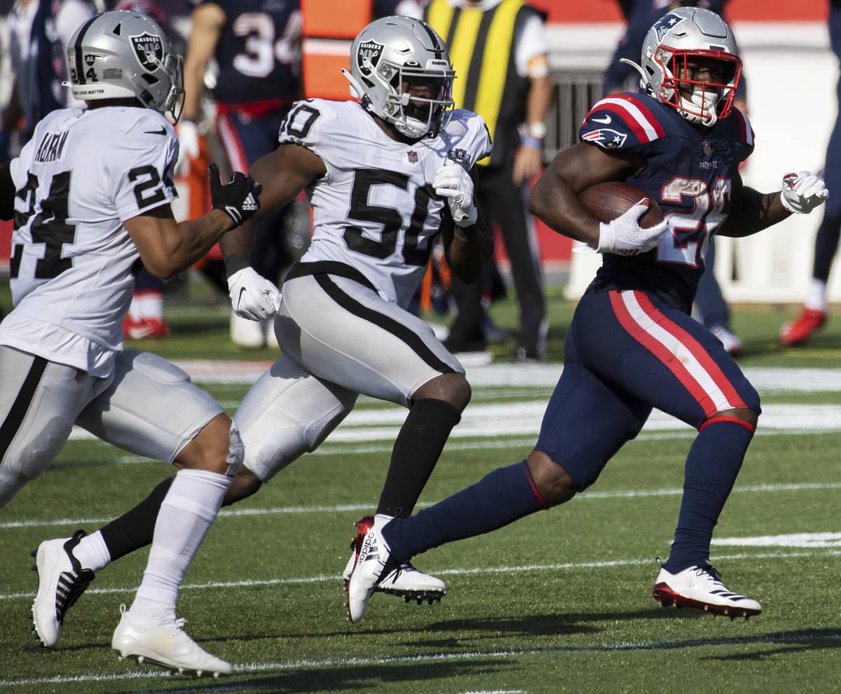 New England Patriots running back Sony Michel (26) breaks into the open field past Las Vegas Ra ...