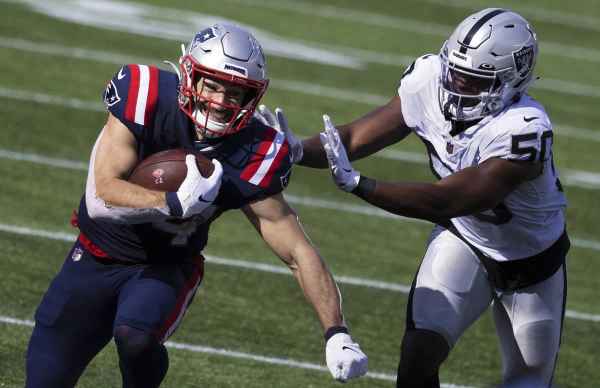 New England Patriots running back Rex Burkhead (34) streaks towards the sideline past Las Vegas ...