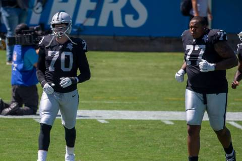 Las Vegas Raiders offensive tackle Sam Young (70), offensive tackle Trent Brown (77) and wide ...