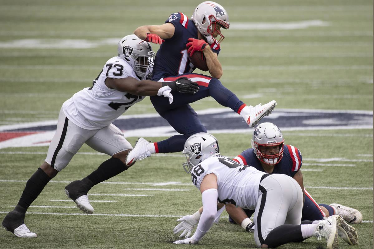 Las Vegas Raiders defensive tackle Maurice Hurst (73) tackles New England Patriots wide receiv ...