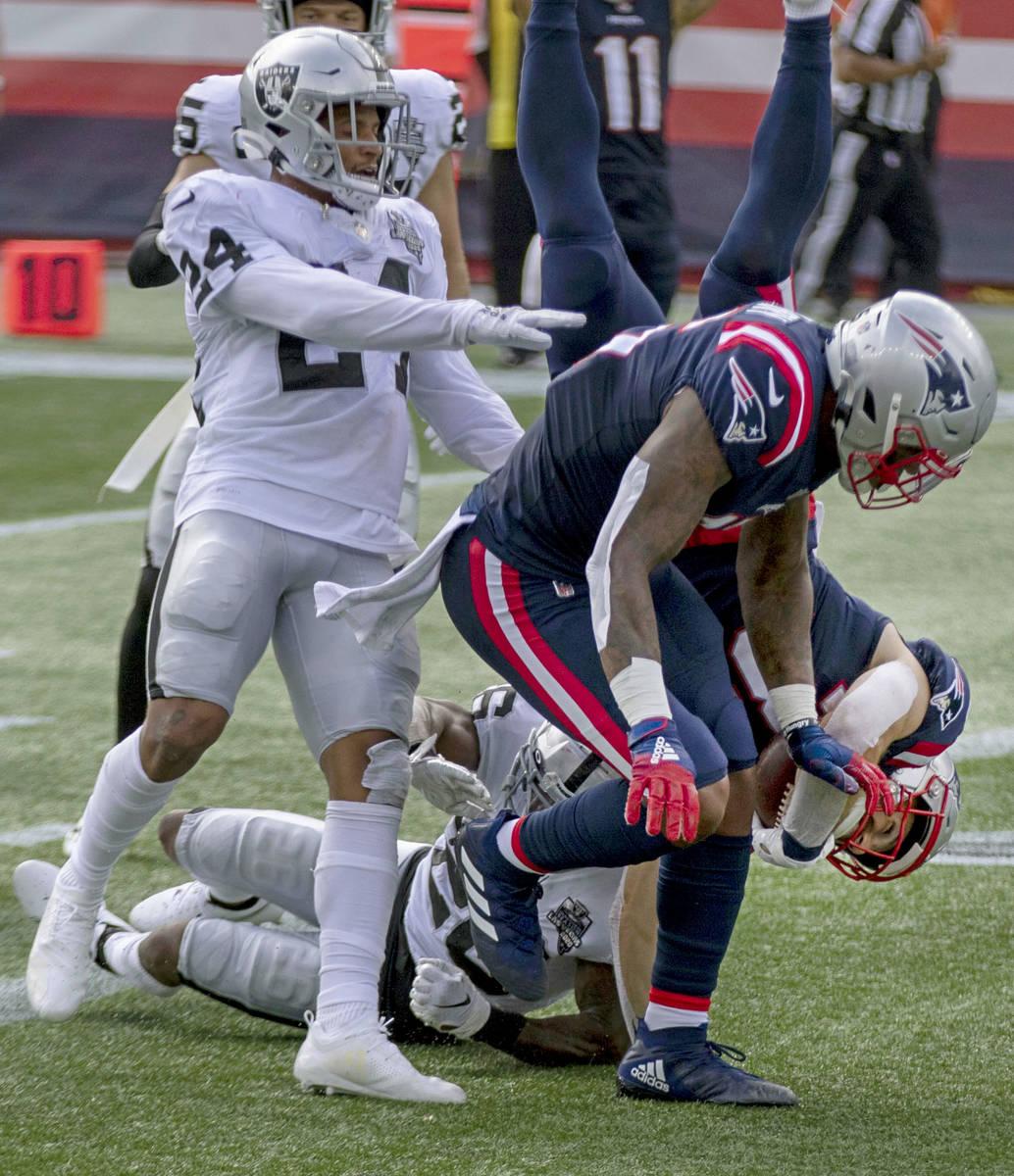New England Patriots running back Rex Burkhead (34) dives into the end zone past Las Vegas Raid ...