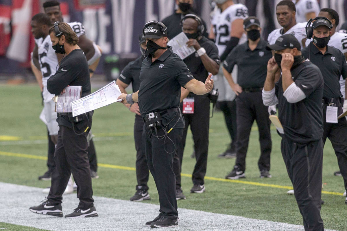 Las Vegas Raiders head coach Jon Gruden, center, reacts as referees review a fumble recovery an ...