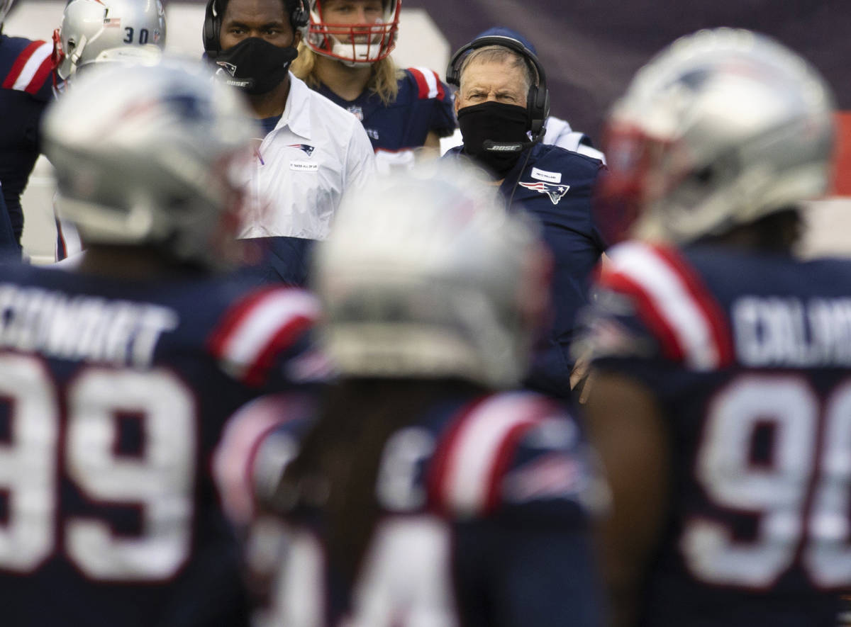 New England Patriots head coach Bill Belichick watches his defense during a time out in the thi ...