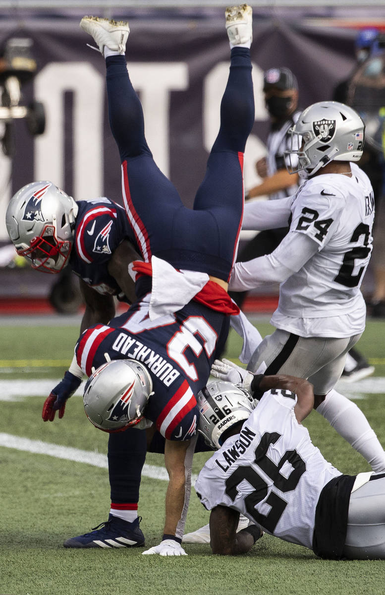 New England Patriots running back Rex Burkhead (34) leaps into the end zone for a touchdown pas ...