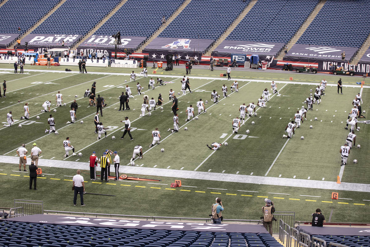 The Las Vegas Raiders warms up before the start of an NFL football game with the New England Pa ...