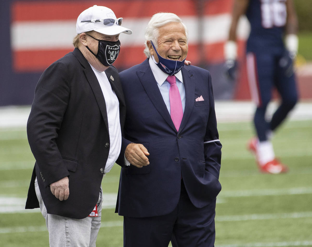 Las Vegas Raiders owner Mark Davis, left, talks with New England Patriots owner Robert Kraft be ...