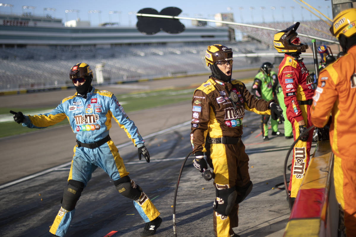 The pit crew for Kyle Busch (18) sends off his car duringa NASCAR Cup Series auto race on ...