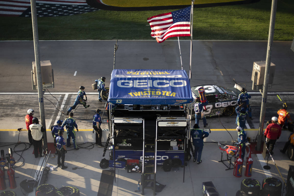 Ty Dillon (13) pulls in for pit stop while his crew rushes to get the job done duringa NA ...