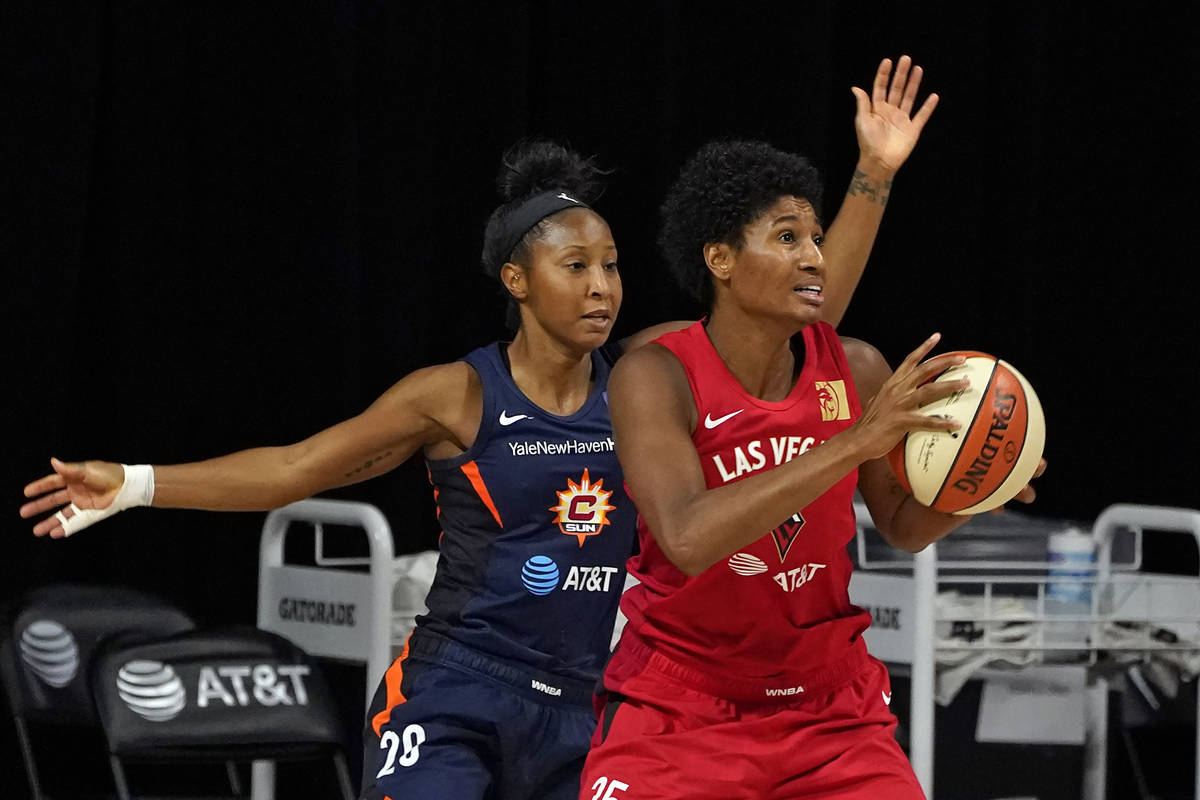 Las Vegas Aces forward Angel McCoughtry (35) goes up against Connecticut Sun guard Briann Janua ...