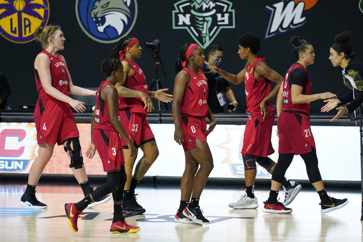 The Las Vegas Aces celebrate their win over the Connecticut Sun during Game 4 of a WNBA basketb ...