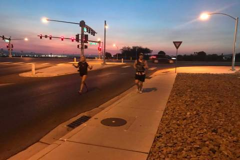 Christina Gruber and James Bristow were the first ones to finish the 5K. (Alex Chhith Las Vegas ...