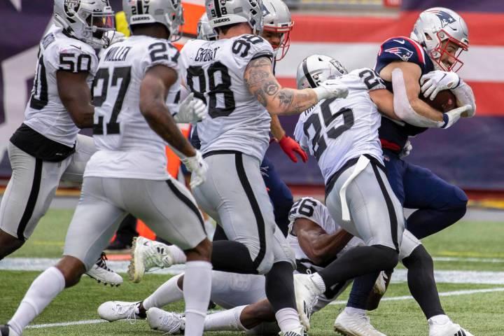 New England Patriots running back Rex Burkhead (34) fights for extra yardage against Las Vegas ...