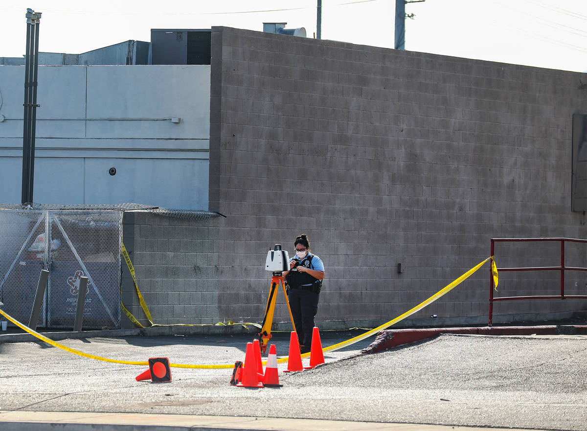 A North Las Vegas police officer works the scene of a homicide where a man was fatally shot Sun ...