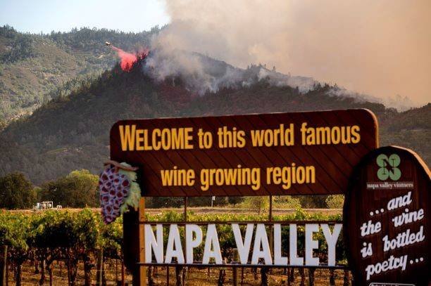 An air tanker drops retardant on the Glass Fire burning in Calistoga, Calif., on Sunday, Sept. ...