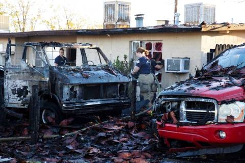 A fire in a recreation vehicle damaged two homes and another vehicle near West Decatur Boulevar ...