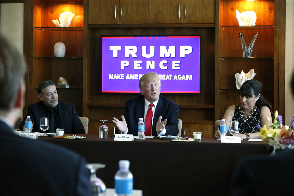 Republican presidential candidate Donald Trump leads a Hispanic leaders and small business owne ...