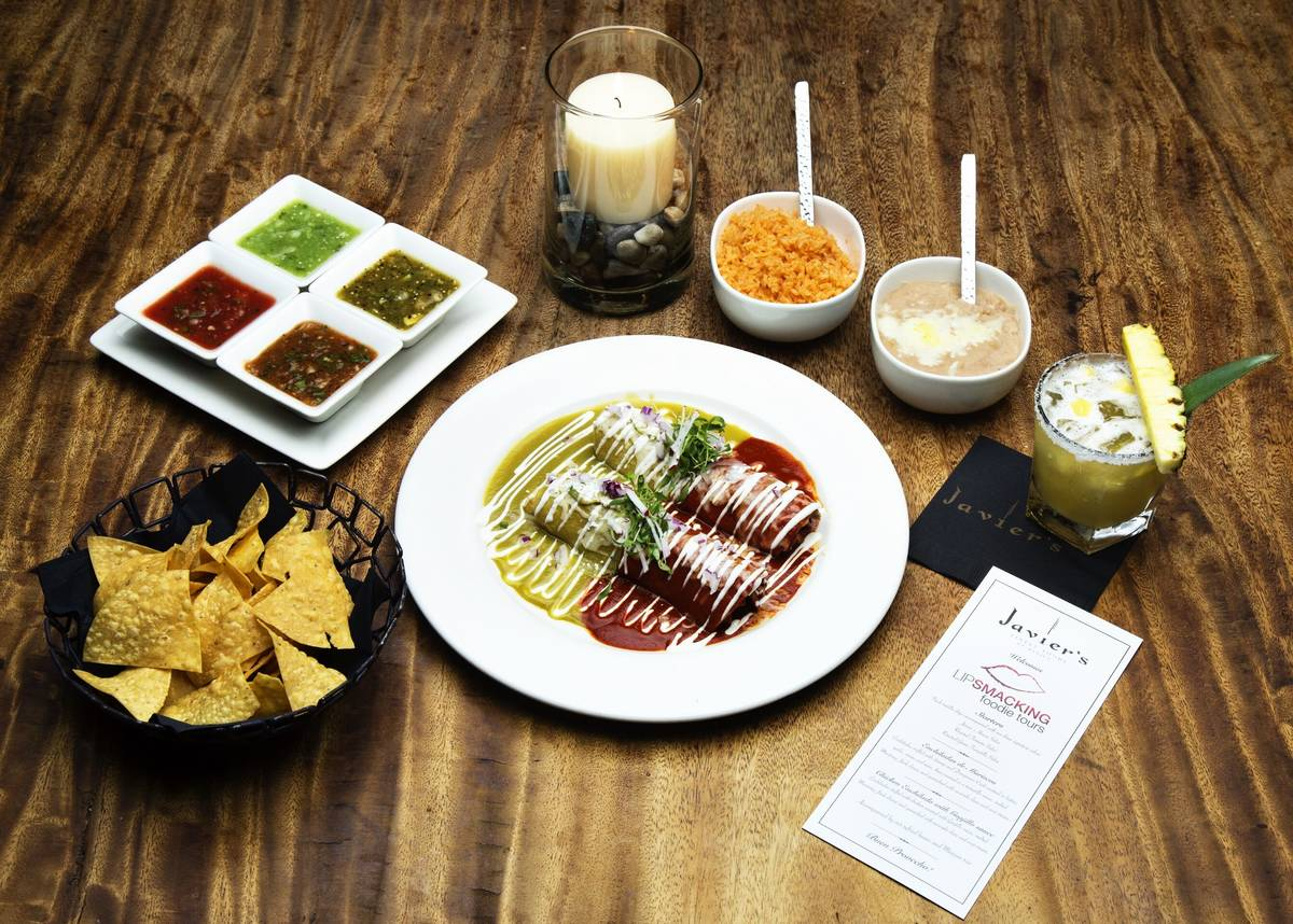An array of food at Javier's at Aria. (Lip Smacking Foodie Tours)