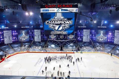 Tampa Bay Lightning players celebrate after defeating the Dallas Stars to win the Stanley Cup i ...