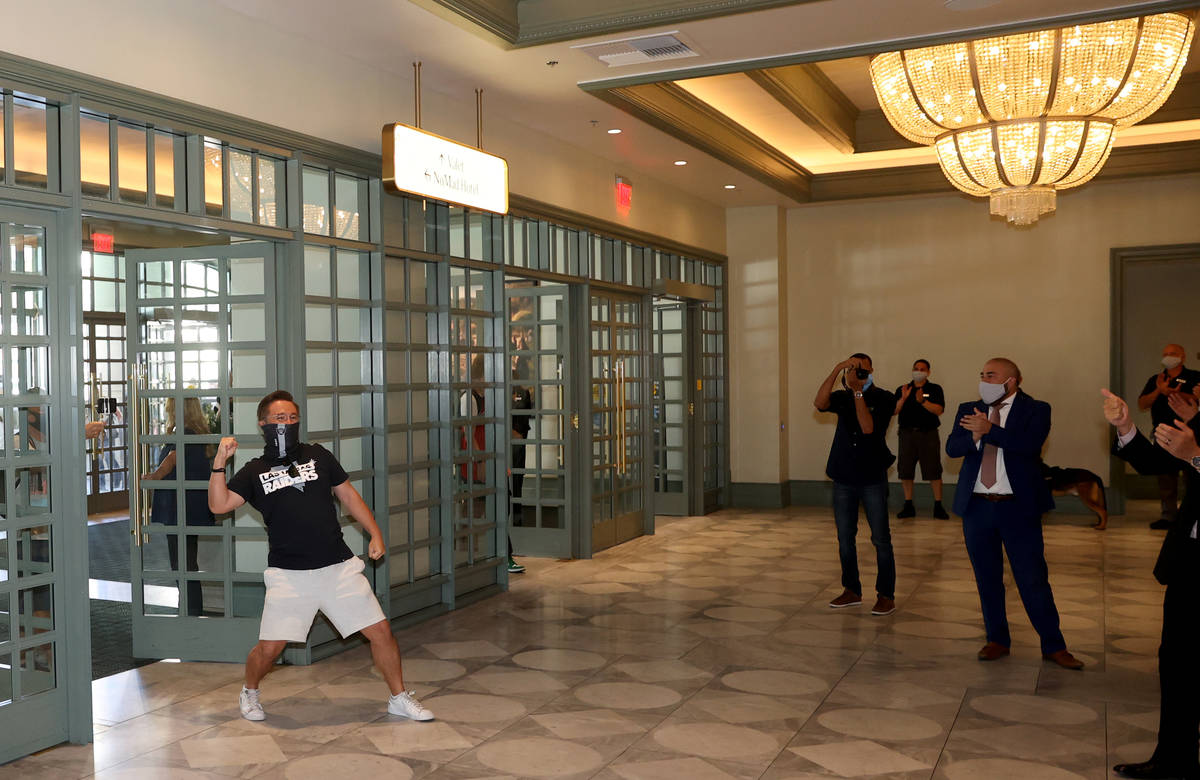 Kohei Munemura of Las Vegas is the first customer through the doors as Park MGM reopens after t ...
