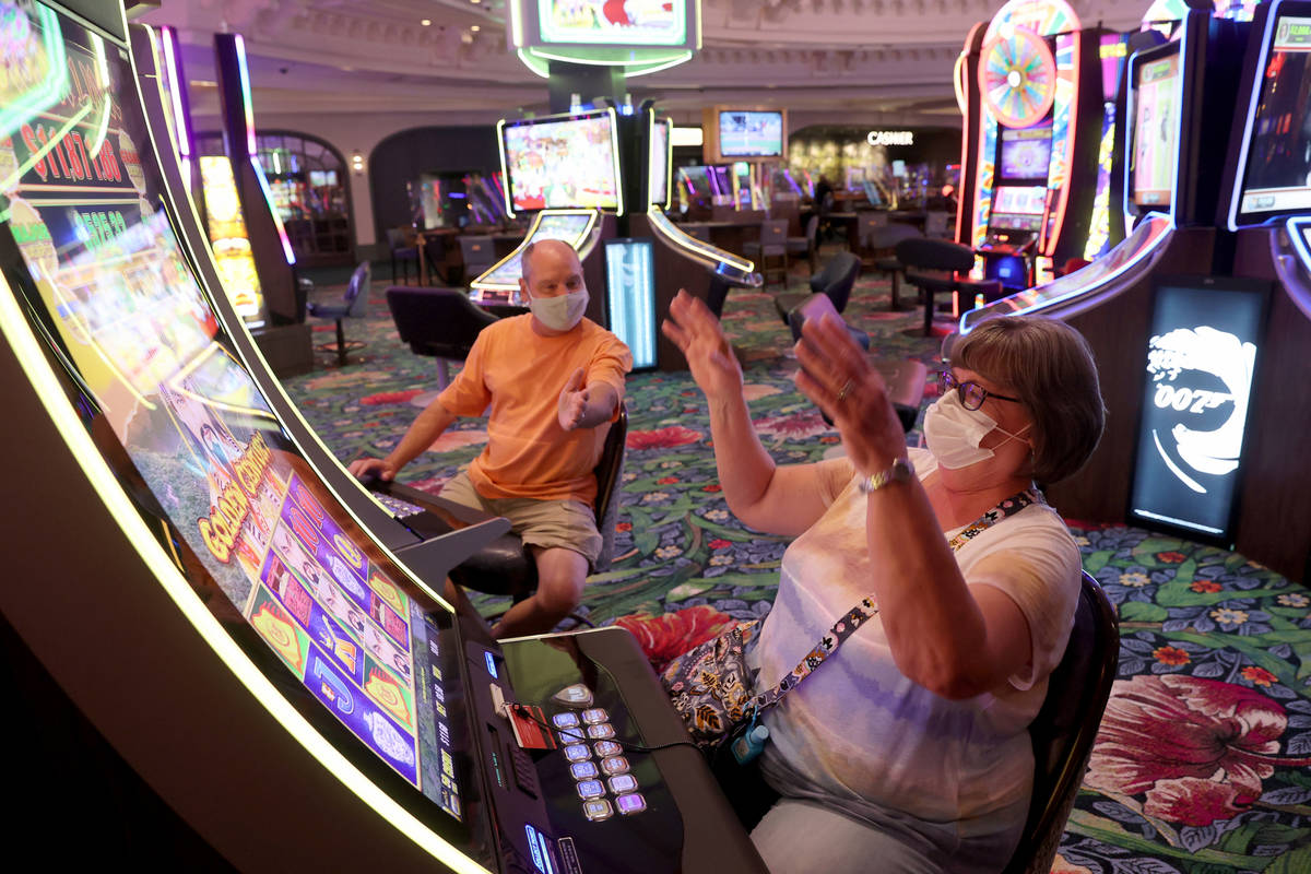 Matt and Donna Daniels of Midlothian, Ill. celebrate a winning play as Park MGM reopens after t ...