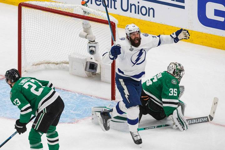 Tampa Bay Lightning's Pat Maroon (14) watches the puck go in past Dallas Stars' goalie Anton Kh ...