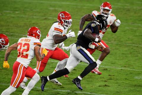 Baltimore Ravens quarterback Lamar Jackson (8) scrambles as he is pursued by Kansas City Chiefs ...